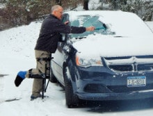 Richard-scraping-car-in-snow-220x167